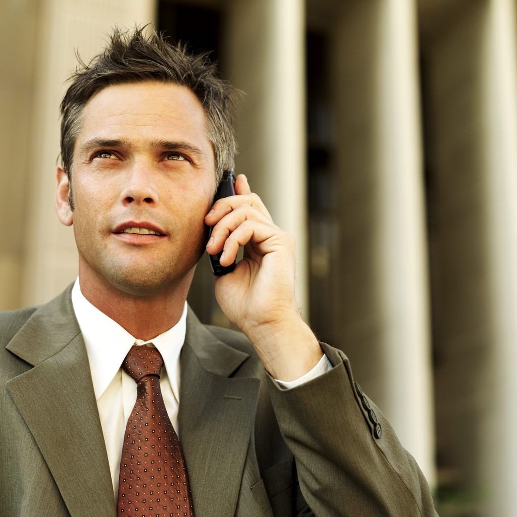 Businessman Talking on a Cell Phone --- Image by © Royalty-Free/Corbis